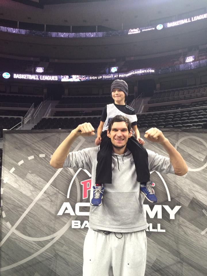 Boban with kid on shoulders
