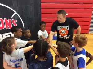 Coach Geo leads a group of players at camp in June of 2017