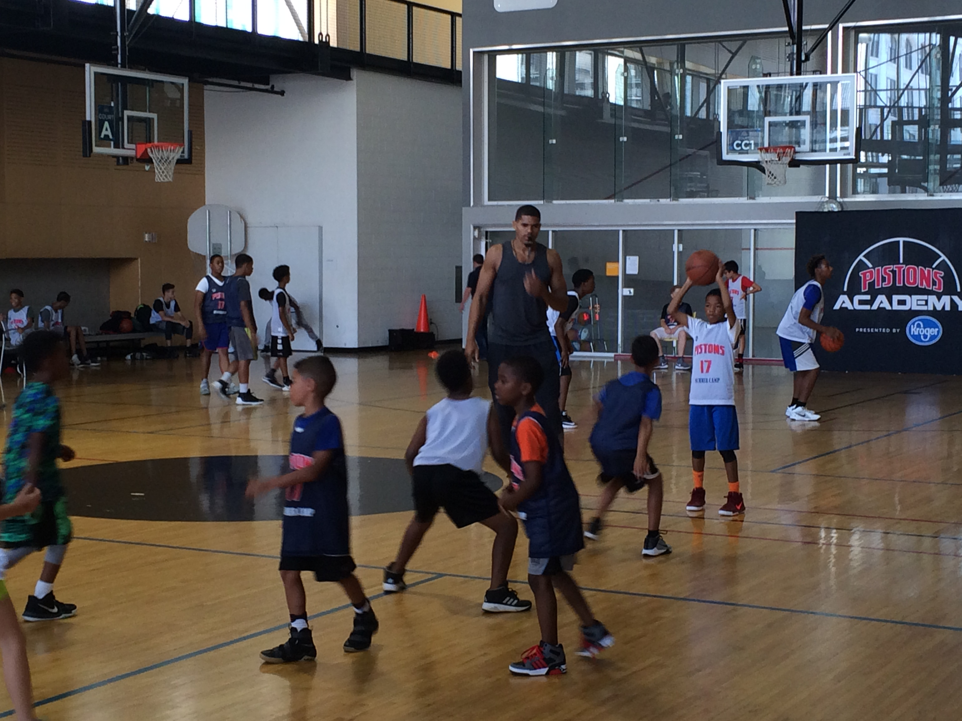 Thrilling thursday as tobias triumphs on court pistons for Harris ymca summer camp