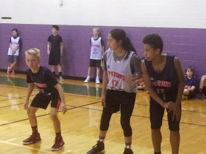 Platinum Division players prepare to rebound a free-throw